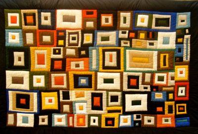 """Edel Lösch """"Inspiration Hundertwasser I"""", Patchworkquilt, (in den Nähten handgequiltet), Baumwolle,Mischgewebe, 220 x 138 cm, Rückseite: schwarz, Baumwolle, Einfassung: sand, handgesäumt"""